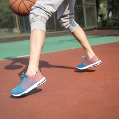Low angle of person playing basketball