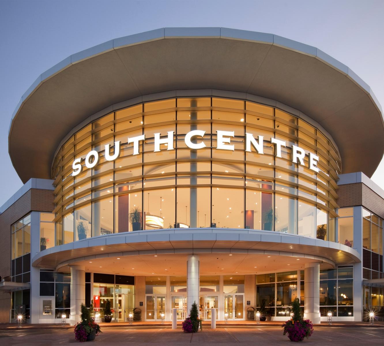 Exterior glass round entrance of Southcentre shopping centre twilight.