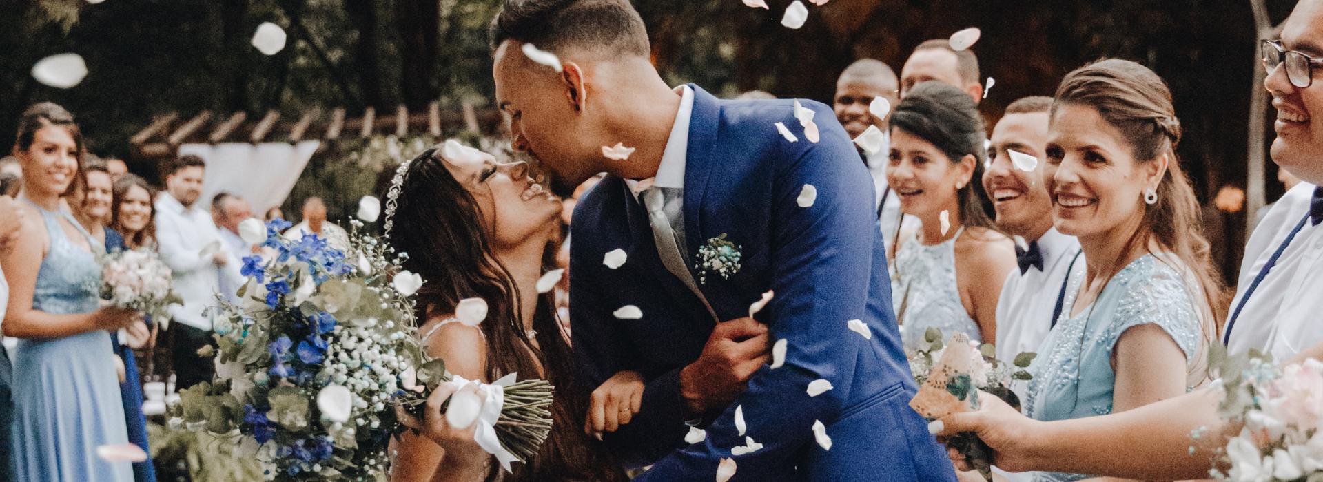Wedding celebration with falling flower petals