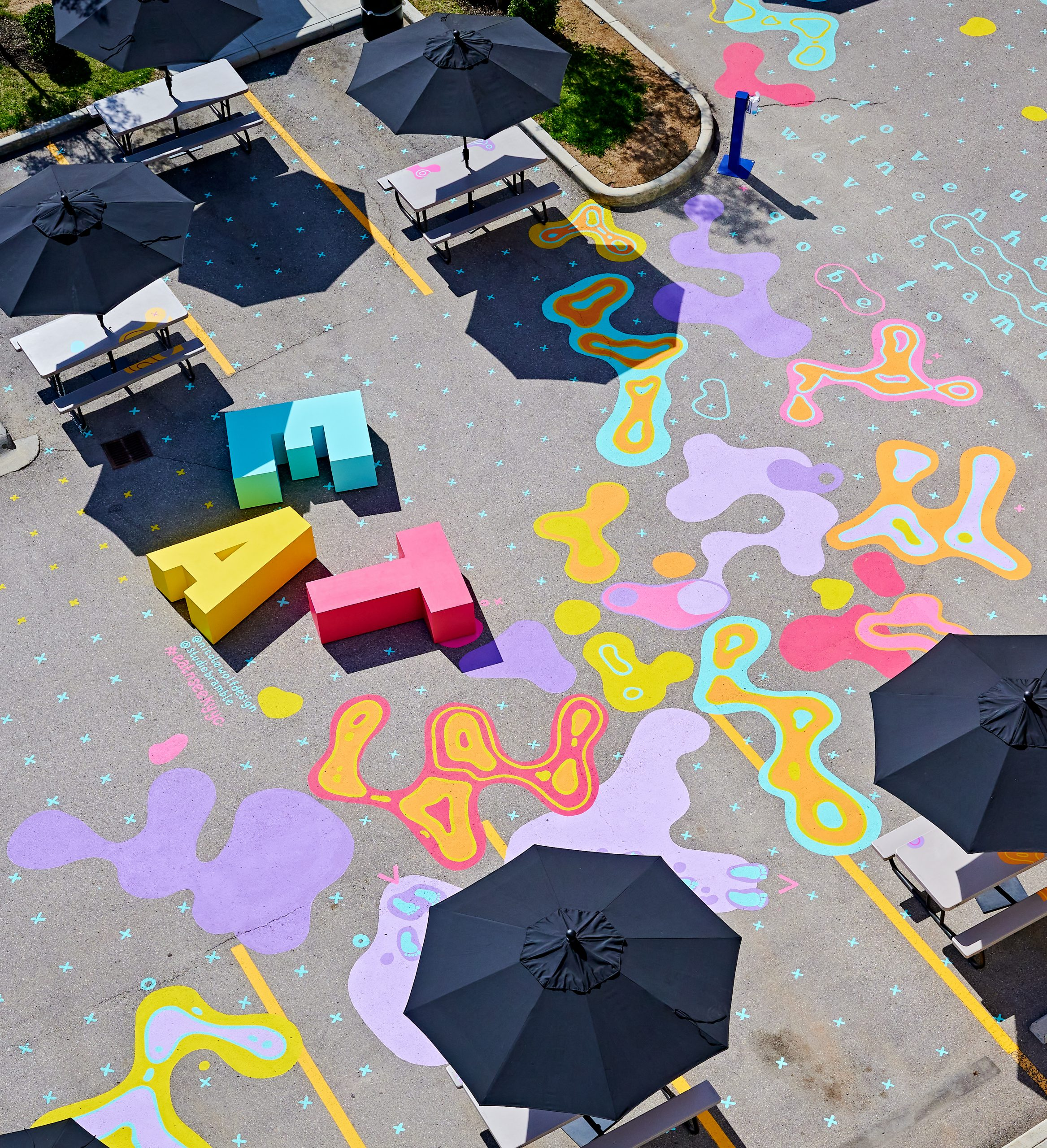 EAT bench and patio umbrellas