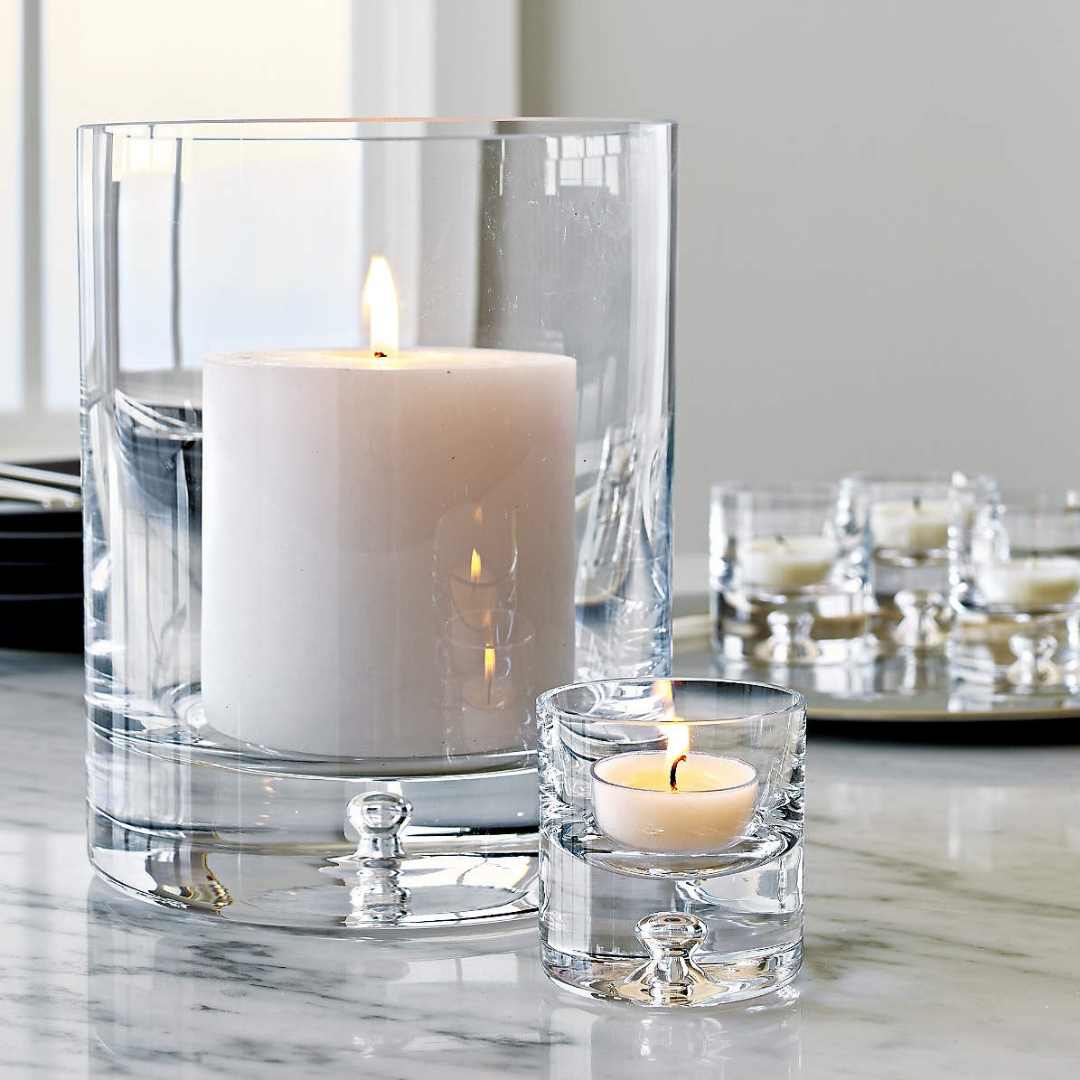 Glass candle holders with light candles