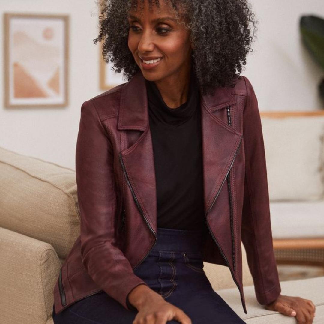 Woman wearing burgundy suede jacket