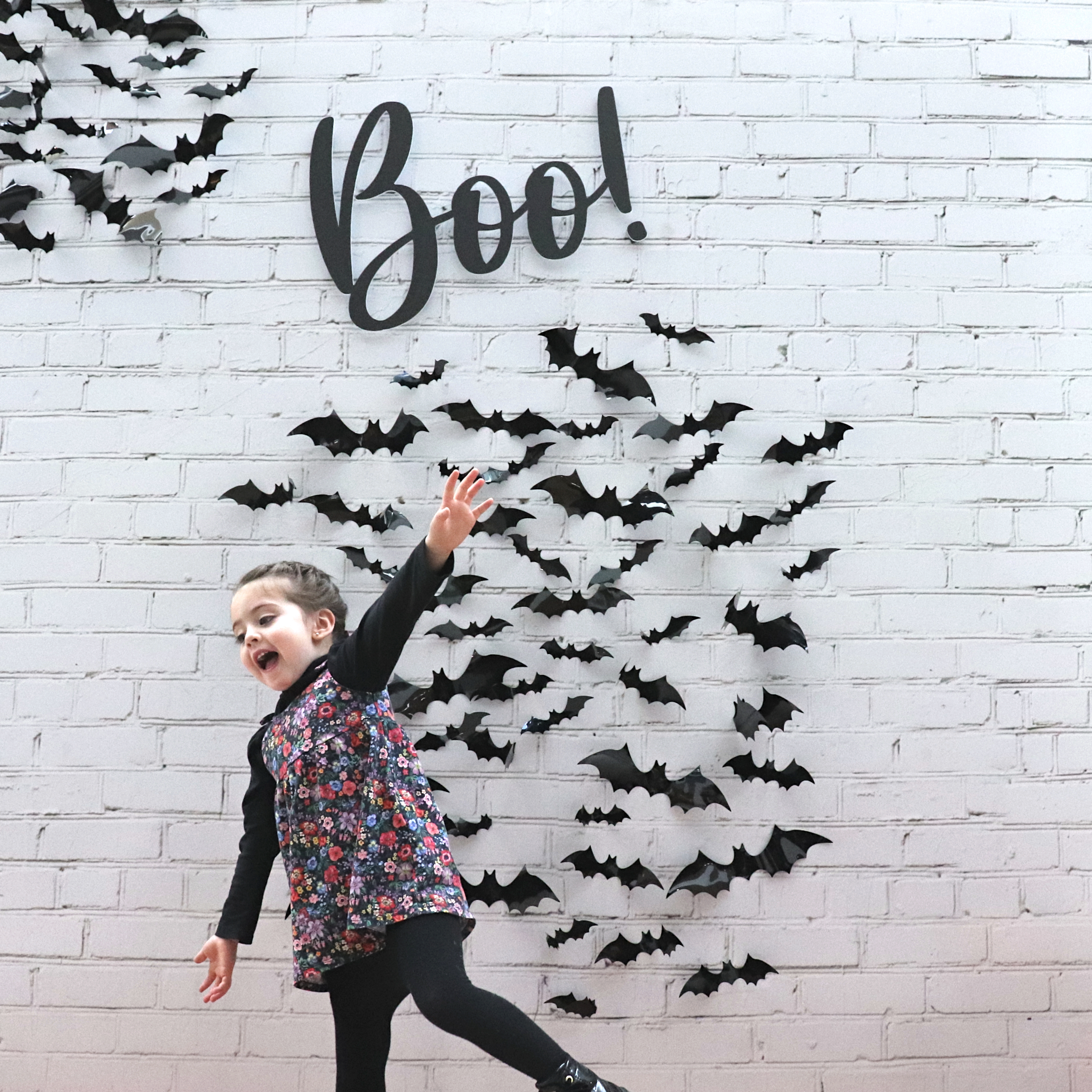 Girl in front of a Halloween display